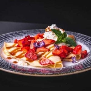French Crepes with strawberries and minth leaf