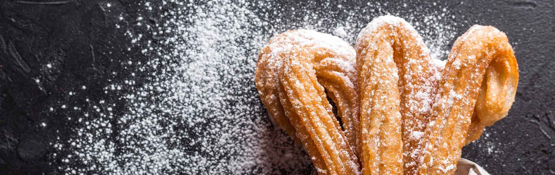 Authentic Spanish food : Delicious Churros with powder sugar