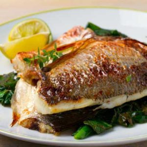 Sea Bream, Estuary orata with vegetables and lemon