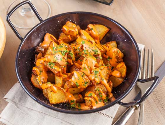 Iberico pork recipe, the patats bravas plate