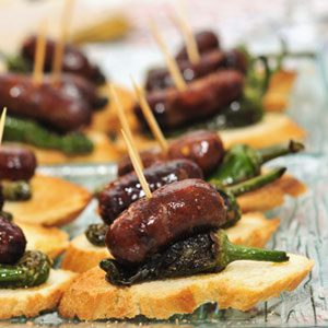 Mini chorizo cooked on bread and anchovies