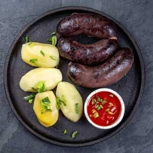 Morcilla sausage cooked with potatoes and sauce