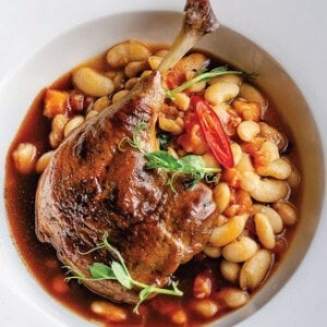 Duck legs confit with beans and wine sauce