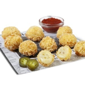 cheese and jalapenos bites with ketchup on a plate