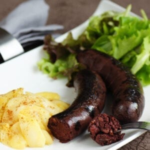 2 boudin noir - butifarra cooked with potatoes and salad